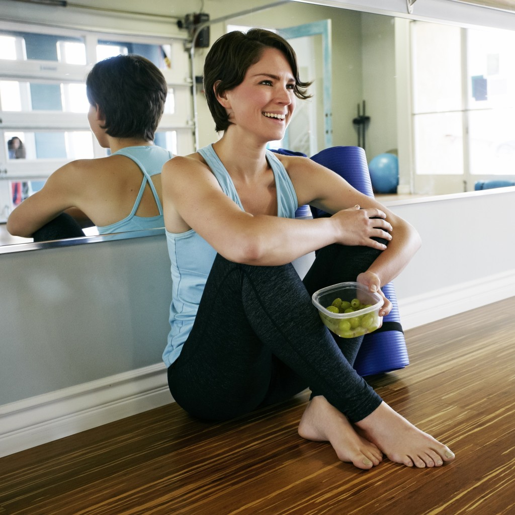 04 Apr 2014 --- Caucasian woman smiling in yoga studio --- Image by © Peathegee Inc/Blend Images/Corbis